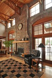 The two story great room includes a reclaimed brick and stone fireplace.