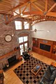 A view from the second floor balcony shows off the fir ceilings and custom handmade cherry cabinetry in the great room.