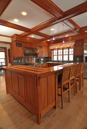 The kitchen includes GE Monogram appliances and slate counters.