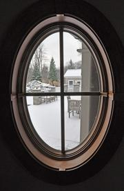 A view from the mudroom of the snow covered bluestone patio.