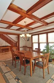 The formal dining room's cherry coffered ceiling.