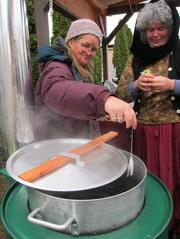 Villager Rhonda adds tea bags to boiling water, preparing a hot drink for a cold day.