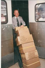 Cal Turner Jr. moves boxes when he was CEO of Dollar General.