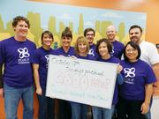 Another Affinity Plus team packed food for Second Harvest in November.