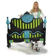 Tracey Bellion holds the headboard and footboard set she painted and sold on Etsy through her shop Tracey's Fancy.