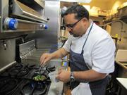 """Chef Kevin Sbraga, winner of """"Top Chef: Season Seven,"""" at work in the tiny kitchen at The Fat Ham."""