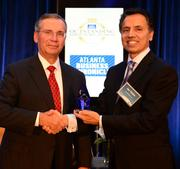 Jay Yadav, CEO of CardioMEMS Inc., (right) presented John Huntz with the Outstanding Directors award.