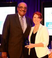 Lauren Koontz with Metro YMCA presented Milton Jones with the Outstanding Directors award.