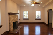 6906 Washington Ave.: The living area with a fireplace.