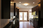 6906 Washington Ave.: The kitchen features 42-inch cabinets, granite counters and hardwood floors.
