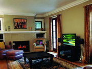 6645 Waterman Ave.: The living room features a brick facade fireplace.