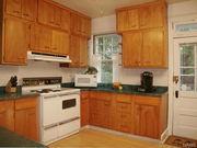 6645 Waterman Ave.: The kitchen has granite counters and a glass accented back splash.