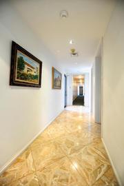 Custom tile work in the hallway.