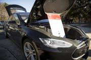 """A Tesla Model S was on display at N.C. State's Centennial Campus during the """"Workplace Charging"""" event, which was sponsored by NCPEV Task Force and Advanced Energy on Dec. 11, 2013."""