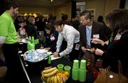 Attendees of the 2013 Humana Healthiest Employer of the Triangle event visits the Humana table.