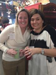 Courtney Kounkel and Dana Kettle attend the 2013 Women Who Mean Business holiday luncheon at the Culinary Center of Kansas City. The annual event brings together alumni of the Women Who Mean Business program.