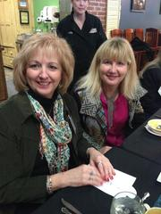 Laura Laiben and Melody Warren attend the 2013 Women Who Mean Business holiday luncheon at the Culinary Center of Kansas City. The annual event brings together alumni of the Women Who Mean Business program.