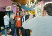 Paul Washington, executive director of the Denver Office of Economic Development, far right, poses for a photo in the Voodoo Doughnut store on Colfax with store owner, Tres Shannon and Turid Nagel-Casebolt, Business Development at OED. Derek Woodbury take the photo.