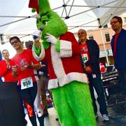 Before San Jose's Santa Run began, the Grinch took the microphone from Carl Guardino of Silicon Valley Leadership Group (to his immediate left) and downtown City Council Member Sam Liccardo (far left).