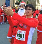 This being 2013, not only do you expect to find plenty of elfies at a Santa Run, you also expect to find a few selfies, too.