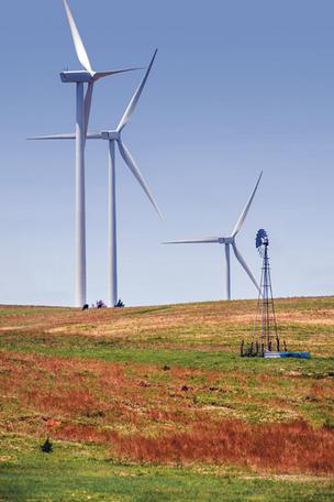 Wind turbines dwarf a traditional windmill along Interstate 70 between Salina and Hays.