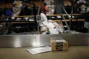 An Amazon.com box moves along a conveyor belt as automated systems sort packages at the UPS Worldport hub.