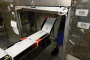 High-tech machines and scanners speed the sorting operations at UPS's Worldport hub.