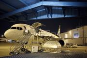 A Boeing jet waits to be loaded at the UPS Worldport hub.