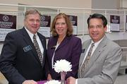 Lori Rousseau, Assistant Vice President of HomeServices Lending, with agents (left) Dennis Creadon and (right) Brad Woods as they admired the Berkshire Hathaway HomeServices signs adorning the Richard Meier-design Ramp in the Atrium of the Stent Family Wing.