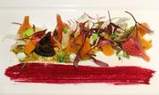 Carpe Vino beet salad with mandarin oranges, fennel, beet greens, crushed pistachios and orange blossom yogurt.