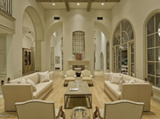 Whether you're freshening up in the master suite, breaking a sweat in the gym, relaxing in the hot tub or lounging in one of the five bedrooms, this 14,000-square-foot Silverleaf mansion in Scottsdale that went on the market in April offers jaw-dropping views of metro Phoenix in every corner. The living room is equally impressive.