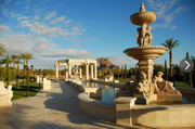This $16 million home in Paradise Valley features five fountains, two outdoor kitchens and a 600-bottle wine cave will make you feel like you've traveled to another continent. With Greco-Roman columns and fountains, Southwestern stone and brick fire pits —plus  small Persian accents throughout — this mansion is a melting pot of architectural styles.