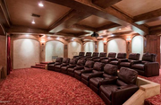 This Scottsdale villa does more than fit the bill of any other mansion that's usually in the eight-figure price range. It features six bedrooms, 10 bathrooms, 10 fireplaces, 12-car garage, 16-seat movie theater (above) with its own popcorn/concession stand, 700-bottle wine cellar and, of course, an elevator.
