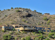 For those who enjoy entertaining and want 16,500 square feet to do so, a mountainside Paradise Valley mansion is on the market for just a shade under $15 million. The luxury pad offers a full bar off the main-level kitchen. The living room has electronic pocket doors that open up to a large drop-edge pool, spa and putting green with backdrop views of the south Valley.