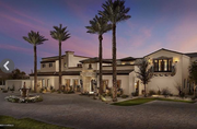 """This Tuscan-style mansion features a heated """"lazy river"""" swimming pool, two exterior in-ground hot tubs, an indoor basketball court, an indoor elevator and two separate guest areas. The estate has three kitchens. The main house includes the main kitchen, with two sinks and two dishwashers, and a second one specifically for catering and service professionals. The third kitchen accompanies one of the guest houses -- a stand-alone residence with three bedrooms, three bathrooms, an exercise/massage room and a private two-car garage."""