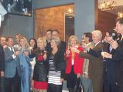 Officials and their guests toast the upcoming hotel in the Epicurean Theatre.