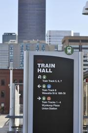 One of the many directional signs at Denver Union Station to guide people to buses and trains.