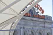 The old Denver Union Station building and the new, gleaming arches over the train tracks and platforms west of the station building.