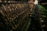 Strung crossbows waiting to be paired with assembled crossbow gun stocks.