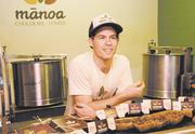 Dylan Butterbaugh, owner of Manoa Chocolate Hawaii, shows product samples. They all say they couldn't succeed without Oahu's visitor industry.