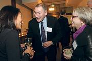 John McAdam (center) shares a laugh with Alane Moran (left), senior director of corporate communications, and Laurie Likai, senior vice president of human resources, during the 2013 Executive Press Dinner.