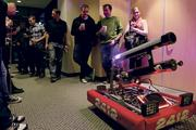 F5 employees watch a T-shirt-shooting robot built by the Sammamish High School First Robotics team, which they sponsor.