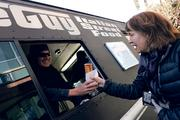 Food trucks show up at F5 headquarters in Seattle at least twice a week. Julie Renouard, a manager in the software development team, gets a meatball sub from WiseGuy Italian Street Food.
