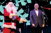 Santa congratulates CEO John McAdam for being named the 2013 PSBJ Executive of the Year at the F5 holiday party.