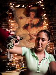 Dos Gatos Bartender Brandy Dampier prepares one of the bar's signature Cocktails.