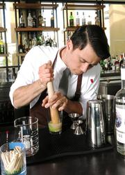 Johnny Schaefer muddles some ingredients while preparing a signature drink at Moxie Kitchen + Cocktails, where he is bar manager.