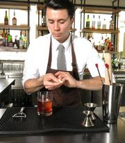 Johnny Schaefer mixing a cocktail at Moxie Kitchen + Cocktails.