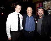 F & M Bank president Scott Rogalski, Edwin Carde of Carde and Associates and Al Gonzalez, exectuive producer of Quad Air Communications Co. pose at the Alliance holiday mixer.