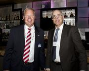 Central Valley Asian-American Chamber of Commerce director of operations Michael Stoneking and Sacramento Hispanic Chamber board member Terry Ward pose at the Alliance holiday mixer.