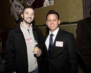 Attendees pose for pictures at the Alliance holiday mixer.